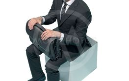 Corporate businessman sitting and waiting