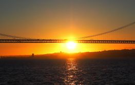 Sunset over 25th april bridge in Lisbon