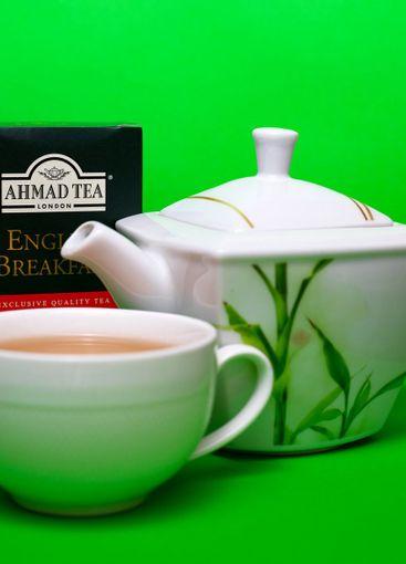 Teapot and cup of Ahmad black leaf tea
