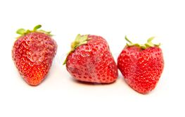 Red strawberry berry on a white background.