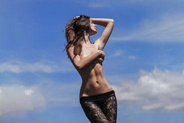 Sensual woman or girl model with slim sexy body and long...