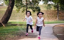 Asian Little Chinese Sisters running happily