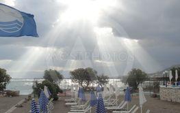 European beach with blue flag