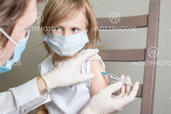 Little child boy or girl is being vaccinated against...