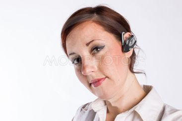 Redheaded Woman with Bluetooth Earpiece