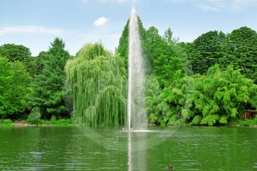fountain in the center of the lake