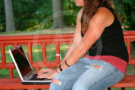 Teen Girl With Laptop Outdoors