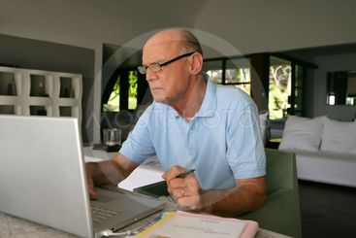 Senior man using a laptop