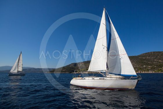 Luxury yachts boats in sailing regatta on the sea.