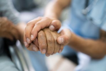 Elder Patient Helping Nurse Hand