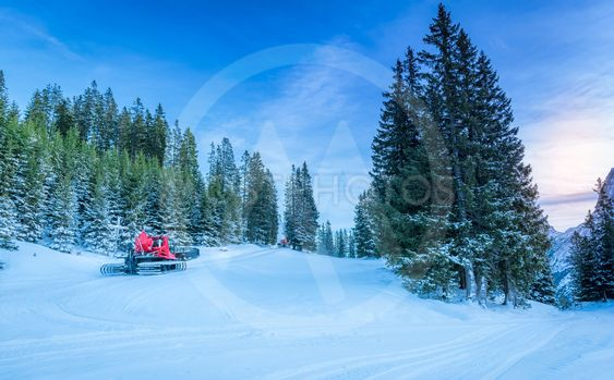 Snowy roads through alpine forest, in Austria