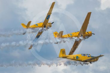 Group of yellow SK 50 in formations in the airshow at...