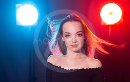 Nightclub, nightlife and people concept - Young woman...