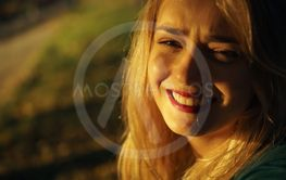 Autumn portrait of young happy smiling girl with red...