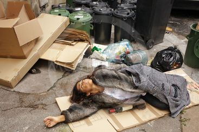 drunk tramp woman in trash