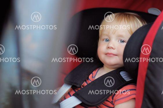 Toddler boy in car seat