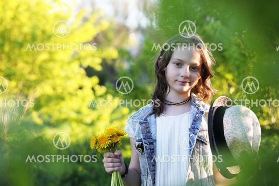 Girl in the park in the spring