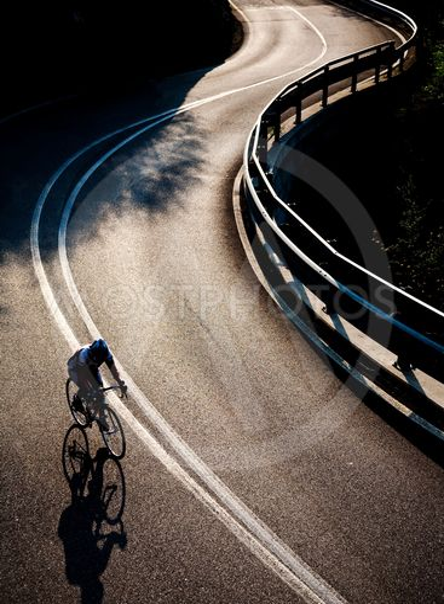 Cyclist riding along a mountain road