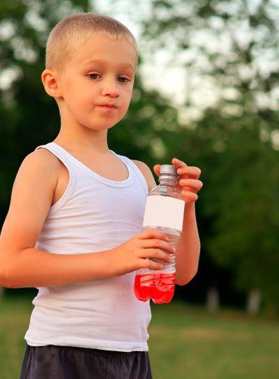 Boy Child caucasian drinking Juice Beverage plastic...