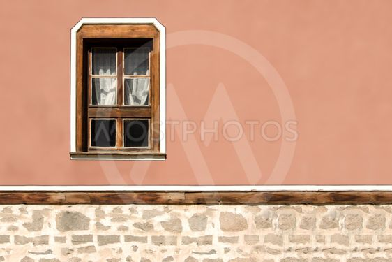 Horizontal part of the facade of the old building in...