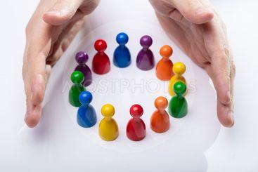 Colorful Pawns Making A Circle