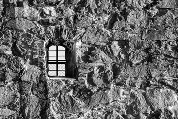 Window with arch in a monochrome photograph.