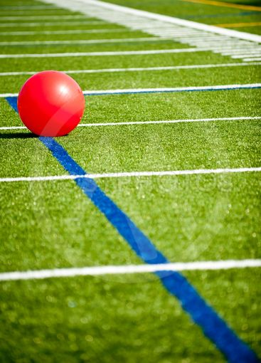 Red ball on part of football field