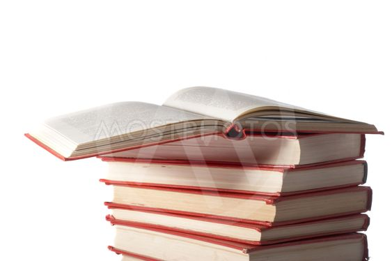 Red books stand on a white background