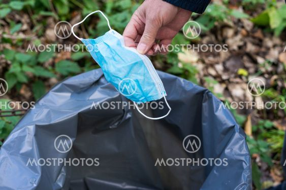 Fresh start concept, throw away a protective mask in the...