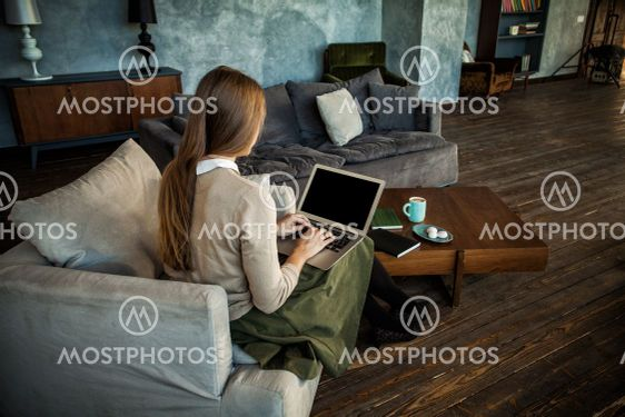Empty Screen Laptop in Female Hands at Home
