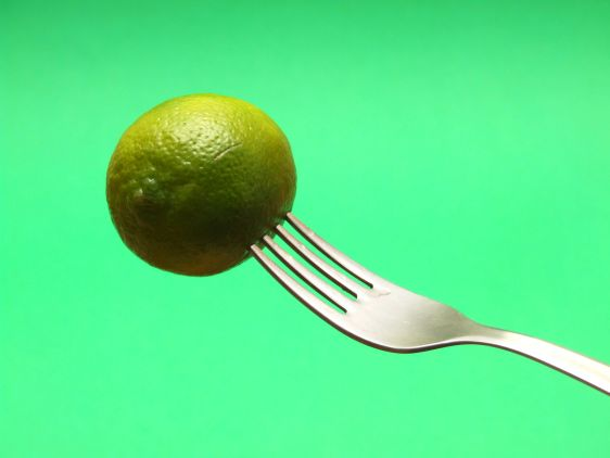 fresh lemon on fork