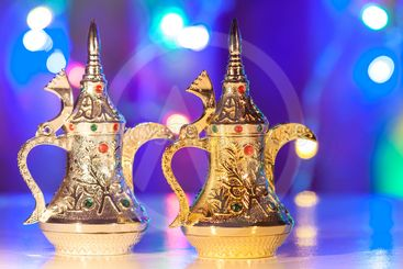 Gold and Silver Arabic Coffee pots in colorful...