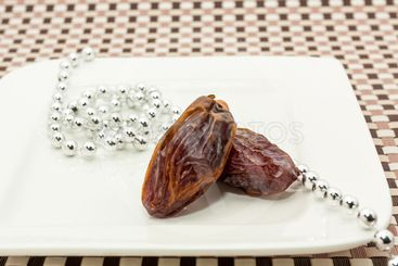 Date fruits in white plate
