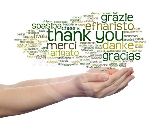 Concept or conceptual abstract thank you word cloud held...