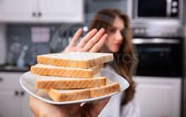 Woman Refusing Bread Slice