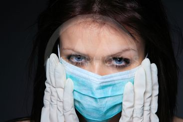 Young nurse in mask