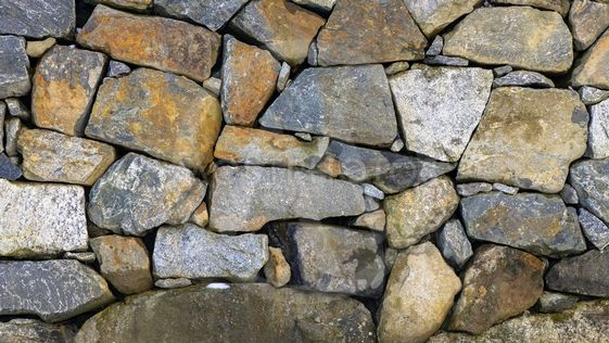 Granite stone wall with colorful stones