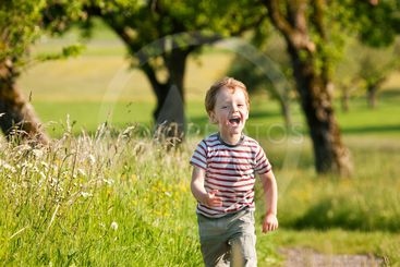 Boy running down a dirtpath