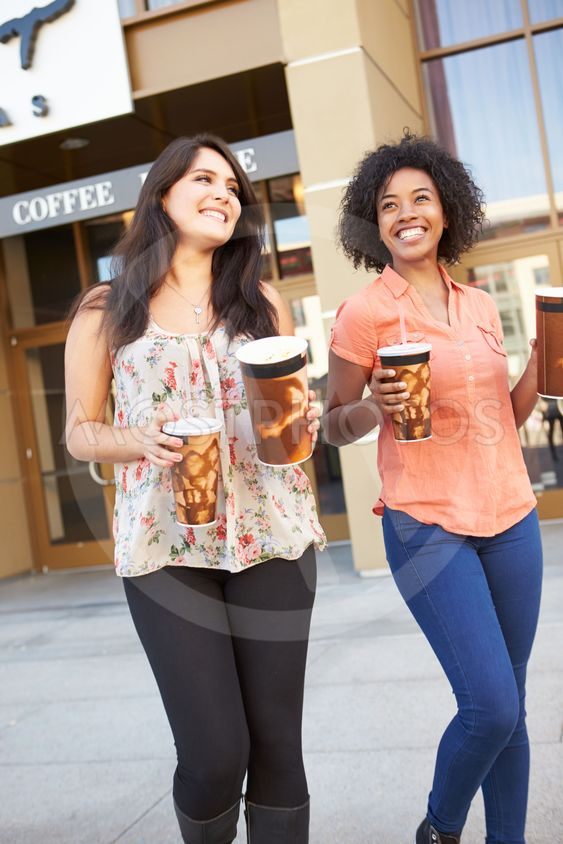 Two Female Friends Standing Outside Cinema Together