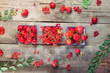 Top view Fresh summer berries - strawberry, cherry and...
