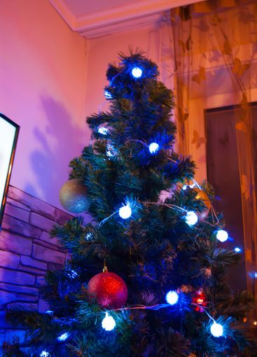 Decorated New Year or Christmas tree in the interior....