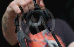 Man photographer holds camera. Photographer concept