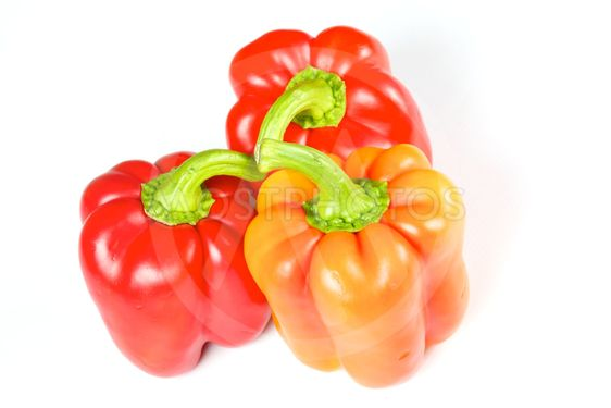 Orange and red pepper isolated on white