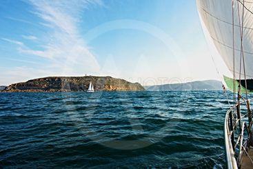 Cruising Sailing Yacht, at sea under sail.