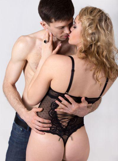 Half naked young couple kissing