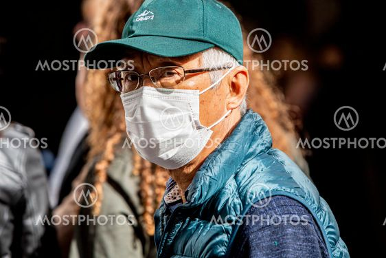 Unidentified man in Seville Spain wearing mask to...