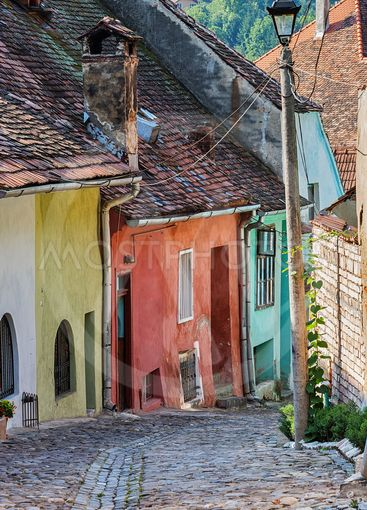 Picturesque alley in ancient Sighisoara, Romania.