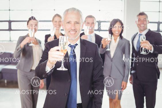 Portrait of businessman holding champagne flute