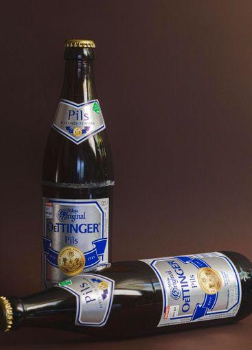 two bottles of oettinger pilsner beer
