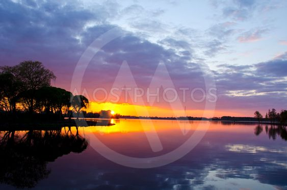 summer lake sunset. Boats sky reflections water
